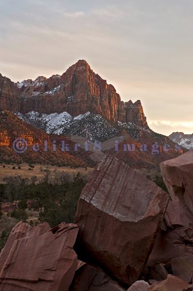 The Watchman at sunset looking southeast up above highway 9 by the Canyon Junction Bridge.