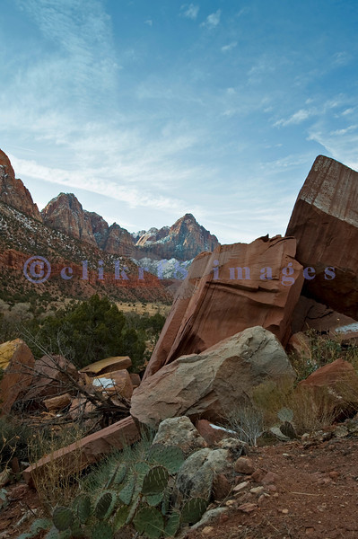 Up off the road by Canyon Junction Bridge, looking southeast toward The Watchman at sunrise.