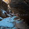 A small slot canyon called Keyhole lies hidden by Highway 9 as it snakes through Zion toward the East entrance just past the long tunnel. We were there in mid-afternoon to catch the glow of the sun on the red bluffs. It entailed an icy climb down into a creek bed then a scramble over some small boulders.