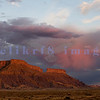 Storm clouds pass through the San Rafael Swell  and Caineville Badlands in the early morning light before sunrise.