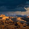 The golden light of sunrise highlight the sandstone just outside of Goblin Valley State Park in Utah.