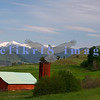 This farm is now a state conservation area. It can be found on the road to Pearrygin Lake near Winthrop. The next morning the clouds broke and revealed the Cascade range covered with snow.