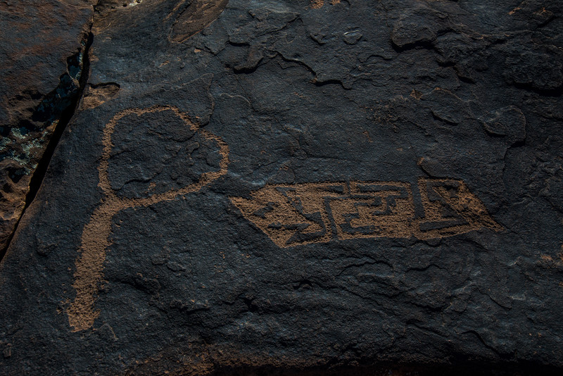 """Rock art is also not a crude attempt at an alphabet or a universal language. It was not writing in the modern sense of the word. Panels of rock art cannot be read from left to right like the pages of a book.<br /> Still, rock art, like writing, may have served as storytelling symbols. It was a tangible attempt to portray human hopes and fears and beliefs in something more lasting than the spoken word. Each piece of rock art is like a verse in the long poem of our attempt to come to grips with the elements of both the physical and spiritual landscape in which we live. Rock art creates those verses in stone.<br /> The images, like hieroglyphs, may represent interactions with the spirit world, display familiar icons, recount stories, record events, or mark trails, territorial boundaries, or locations where water could be found.<br /> There are an infinite number of things one could think of that the symbols might mean. For example, there are at least five separate interpretations of a circle: That it represents the universe; a shield (the bird of prey was often associated with warrior societies); the sun; nearby water; or an eye (the all-seeing power of the bird-man). We may never learn what the person who carved or applied the paint intended the figures to be, whether a """"work of art"""" in the modern sense, a ceremonial object, or a territorial marker. We have found no Rosetta Stone.<br /> Clearly, however, rock art is an expression of humanity, symbols of a culture that have persisted for millennia. Someone took time from a life that, if it wasn't nasty, brutish and short (thank you Thomas Hobbes), was unforgiving, to create these images, and that person took pains to make them last.<br /> The symbols have lasted, while the society that made them possible has not. Rock art images transmit the spirit of their creator into an uncomprehending age."""