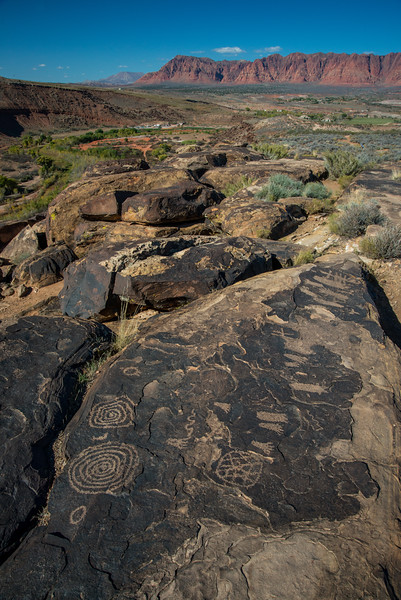 """In general, the spiral found in both rock art and ceramics may simply connote motion, with a clockwise spiral denoting ascension and a counterclockwise spiral denoting descension. 5  (Was it not Jung who stated that clockwise motion represents the conscious, while anticlockwise motion signals the unconscious?) According to author Ani Bealaura, the spiral is manifested in the upper and middle worlds in a direction opposite to that of the underworld. """"The right hand, deocil, or clockwise motion in Celtic belief represents the emerging, growing, material manifestation of energy. This is the direction in which one would cast the circle of protection and send energy into the environment. It is also used to banish unwanted energies. The left hand, widdershin, or counter clockwise motion represents the inward turn and to draw energy into material manifestation. It is the principle of grounding energy. It is also used to take the inner journey of gaining insight and enlightenment, and takes one to the 'underworld' or 'dreamtime'. It is also related to seeking Cerridwen's Cauldron of Inspiration."""" 6 The mythological poet Robert Graves claims that the Celtic god Bran (the Greek Cronos and the Roman Saturn, whom we have identified with the Hopi Masau'u) was associated with the alder, whose buds are set in a spiral pattern. This, he says, is """"a token of resurrection. 7. Graves also recalls the Celtic designation for the megalithic site of Newgrange in Ireland as the Spiral Castle. """"In front of the doorway of New Grange there is a broad slab carved with spirals, which forms part of the stone henge. The spirals are double ones: follow the lines with your finger from outside to inside and when you reach the centre, there is the head of another spiral coiled in the reverse direction to take you out of the maze again. So the pattern typifies death and rebirth..."""" 8  John Frayne, an artisan of Celtic jewelry, states that spiral of opposing directions refer to solstice suns: """"A loosel"""