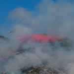 Color marks the area hit by the drop, and the fertilizer encourages regrowth of plants in the burn area. The red stuff is a fire retardant rather than a fire extinguisher, slowing progress t ...