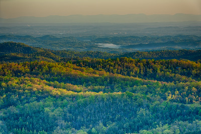 USA, Tennessee, Cherohala Skyway. Scenic vista of rolling hills and fog at sunrise.