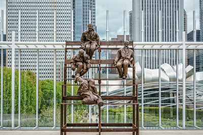 USA, Chicago, ILL. Sculpture by Juan Muñoz: Thirteen Laughing at Each Other, The Art Institute.