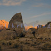 Hollywood filmed many movies and Western TV shows in the Alabama Hills, large strangely shaped boulders strewn between the Sierra Nevada Range and the high desert of the Owens Valley. Alpenglow highlights the peaks of the Eastern Sierra Nevadas: Lone Pine Peak on the left and Mt Whitney peaking through the boulders.