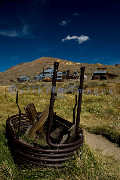 """The town of Bodie, California grew from a gold discovery in the early 1860s. Once populated by 10,000 hardy souls (winters are harsh at 9,000 feet), Bodie is now the best preserved ghost town in California. Now part of the California State Parks system, it is preserved in a state of """"arrested decay"""". This view looks toward the stamp mills and other mining buildings on the hill side."""