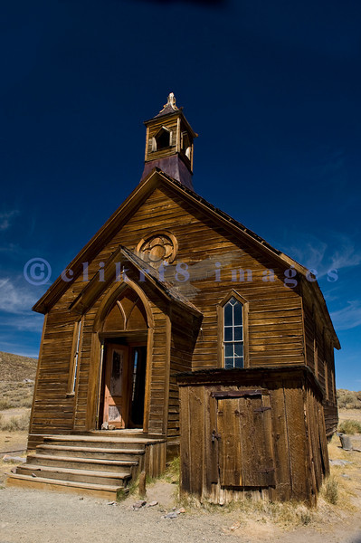 """The town of Bodie, California grew from a gold discovery in the early 1860s. Once populated by 10,000 hardy souls (winters are harsh at 9,000 feet), Bodie is now the best preserved ghost town in California. Now part of the California State Parks system, it is preserved in a state of """"arrested decay"""". Lutheran Church built of Jeffrey pine mellowed to a golden brown over years exposed to the wind, snow and sun of Bodie."""