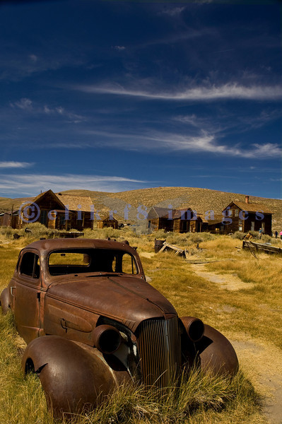"""The town of Bodie, California grew from a gold discovery in the early 1860s. Once populated by 10,000 hardy souls (winters are harsh at 9,000 feet), Bodie is now the best preserved ghost town in California. Now part of the California State Parks system, it is preserved in a state of """"arrested decay"""". I was told this is a 1937 Chevy coupe."""