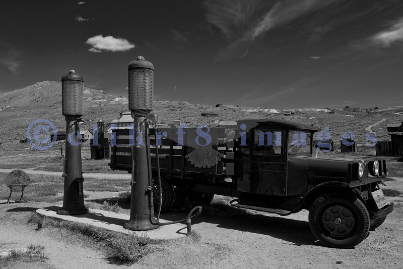 """The town of Bodie, California grew from a gold discovery in the early 1860s. Once populated by 10,000 hardy souls (winters are harsh at 9,000 feet), Bodie is now the best preserved ghost town in California. Now part of the California State Parks system, it is preserved in a state of """"arrested decay"""". A restored truck is ready to gas up at the vintage gas station."""