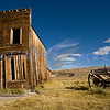 """The town of Bodie, California grew from a gold discovery in the early 1860s. Once populated by 10,000 hardy souls (winters are harsh at 9,000 feet), Bodie is now the best preserved ghost town in California. Now part of the California State Parks system, it is preserved in a state of """"arrested decay"""". This old hotel is listing towards collapse."""
