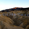 If you can tear yourself from the sunset at Zabriskie Point, turn around to catch the last light on the rock formations behind you.