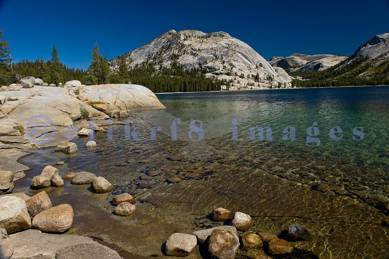 Lake Tenaya is an alpine lake adjacent to California State Highway 120 or Tioga Highway that is the road from Lee Vining to the Eastern entrance to Yosemite National Park. Granite is the dominant stone along the shore.