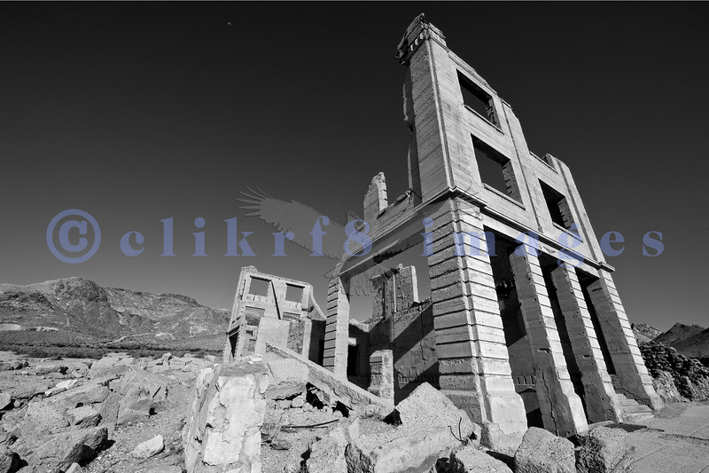 Rhyolite was a booming gold mining town in 1905. Today not much remains. This is the Cook Bank Building, one of the few standing buildings but it too is subject to the ravages of time and gravity.