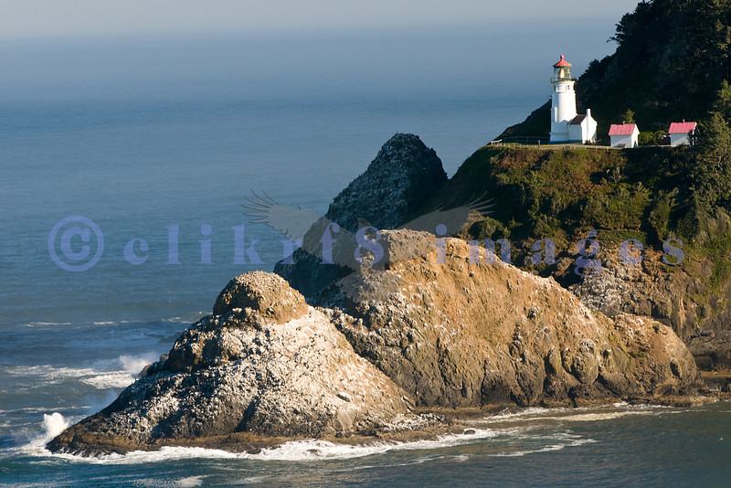 Heceta Head lighthouse in the morning light. You can see the omnipresent fog offshore. This is one of the most photographed lighthouses in the United States.