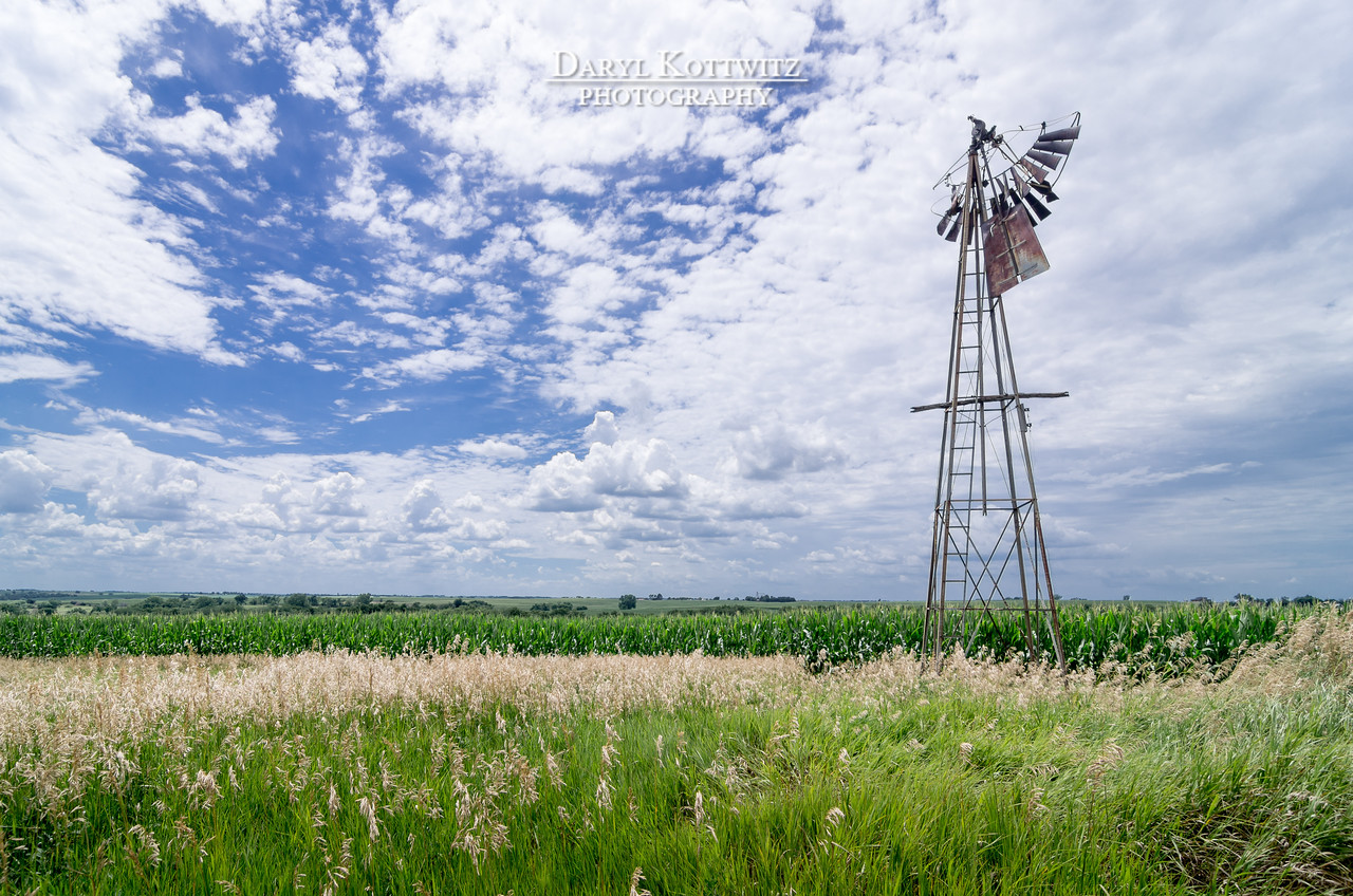 "An old ""wilted"" windmill stands alone along the route between Auburn and Nebraska City in southeast Nebraska.  I almost didn't stop to shoot the scene, but am glad I did (except for the dozen or so chigger bites I experienced).  This is one of several different angles and compositions attempted.  Thanks for viewing."