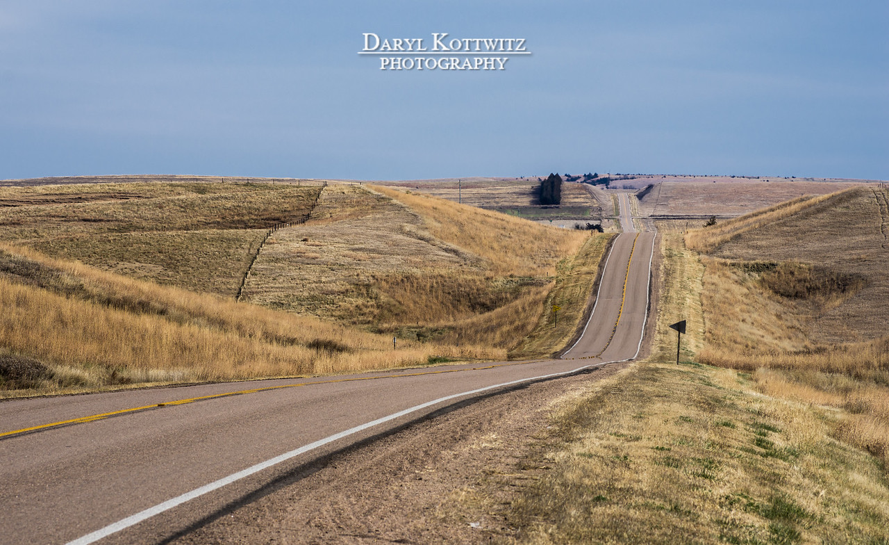 Rural Nebraska road between Ord and Omaha.  There are a lot of views like this.  This is the one I chose to shoot.  There is quite a bit of atmospheric distortion visible in this image, but I still like it.