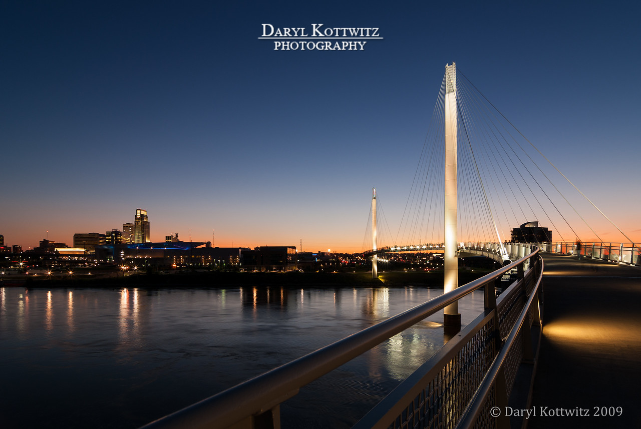 This is the Bob Kerry Pedestrian Bridge connecting Council Bluffs, Iowa and Omaha, Nebraska.  View is from the Council Bluffs side looking toward the downtown Omaha skyline.