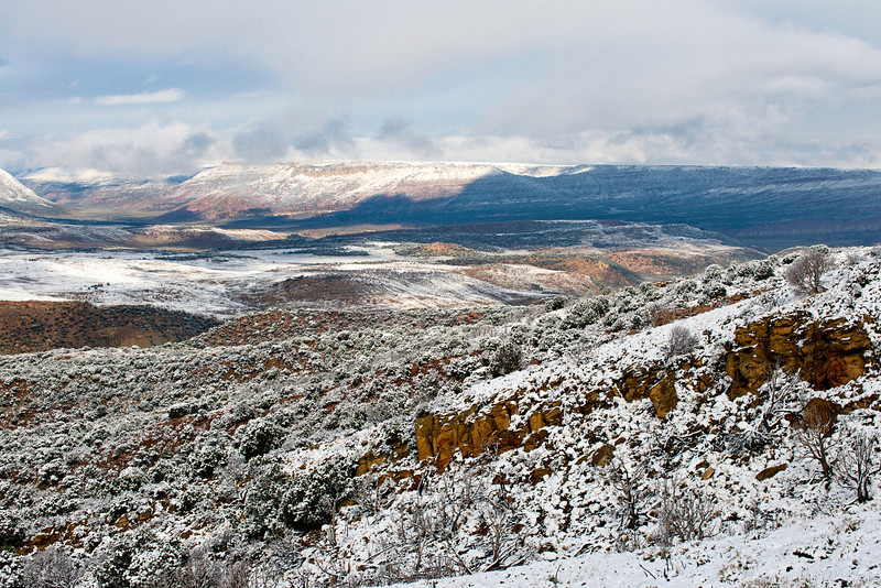 Snow covered red rock country from an overview on Highway 191 north of Vernal, Utah on September 25, 2013 looking toward Flaming Gorge National Recreation Area.