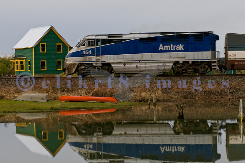 This area is in the small settlement of Blanchard near the world famous Chuckanut Drive. An Amtrak engine is southbound as it passes a slough.