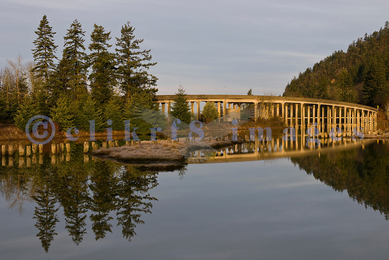 This area is in the small settlement of Blanchard near the world famous Chuckanut Drive. The bridge is bathed in early morning light.