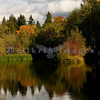 Derby Pond in Bellingham's Whatcom Falls Park reflects late October's fall foliage.