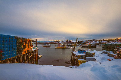 Acadia National Park, Maine, USA.  A colorful fishing village at dusk during winter.