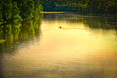 USA, Indiana.  Lone canoer on the Wabash River at Davis Ferry