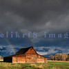 A storm rolls over the Moulton Barn in Wyoming's Grand Tetons National Park obscuring the dramatic backdrop of the namesake mountain range. A parting of the clouds rewarded us with a double rainbow.