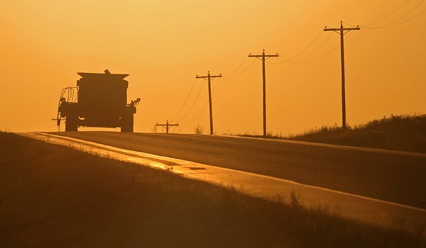 A giant combine rumbles along highway 21 near Hay Lakes.