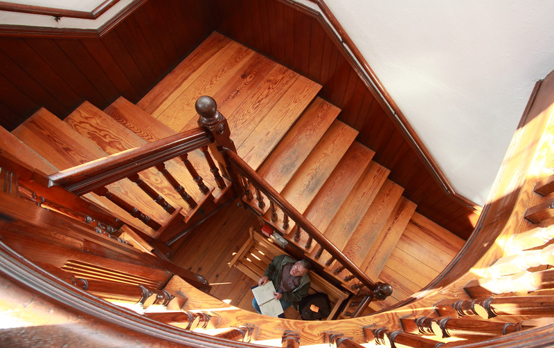 Pete Jackson looks up from the bottom of the staircase in Town Hall as he greets guests on the Municipal Buildings Committee's tours of Hildreth House, Town Hall, and the old library on March 19.