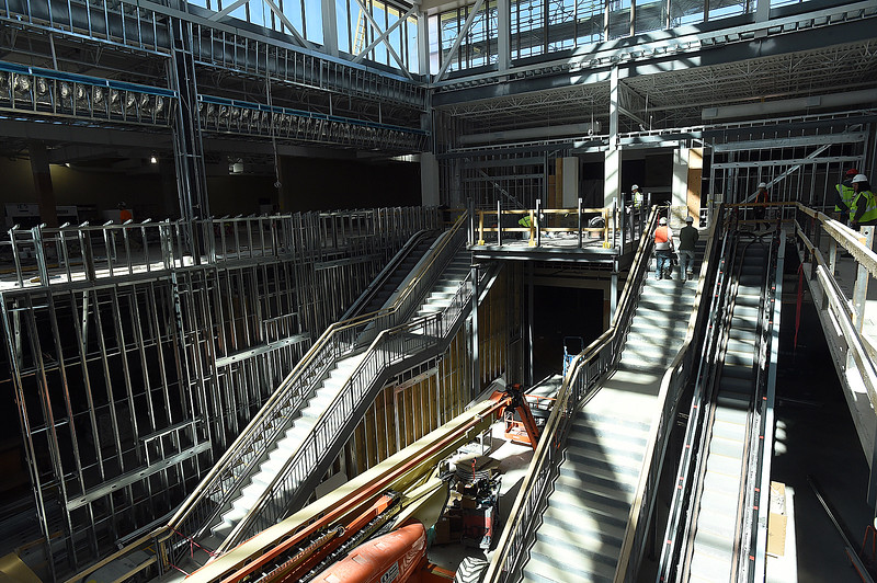 Construction crews work near the staricases and escalators Wednesday, March 1, 2017, at the new Scheels store at the 2534 development in Johnstown. The 250,000 square-foot store plans to open its doors on Sept. 30 of this year. (Photo by Jenny Sparks/Loveland Reporter-Herald)
