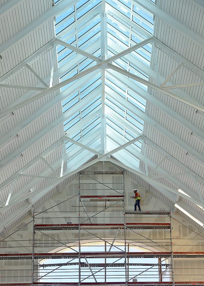 A construction worker stands on scafolding as he works on drywall Wednesday, March 1, 2017, at the new Scheels store at the 2534 development in Johnstown. The 250,000 square-foot store plans to open its doors on Sept. 30 of this year. (Photo by Jenny Sparks/Loveland Reporter-Herald)