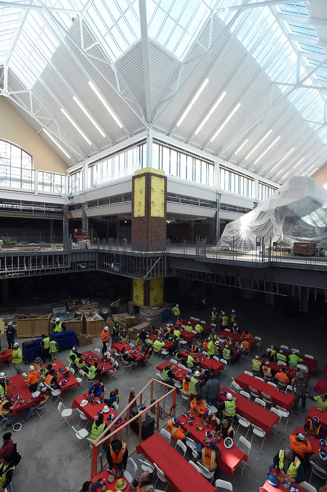 Contractors working to build the new Scheels store have lunch in the atrium Wednesday, March 1, 2017, in Johnstown. The 250,000 square-foot store plans to open its doors on Sept. 30 of this year. (Photo by Jenny Sparks/Loveland Reporter-Herald)