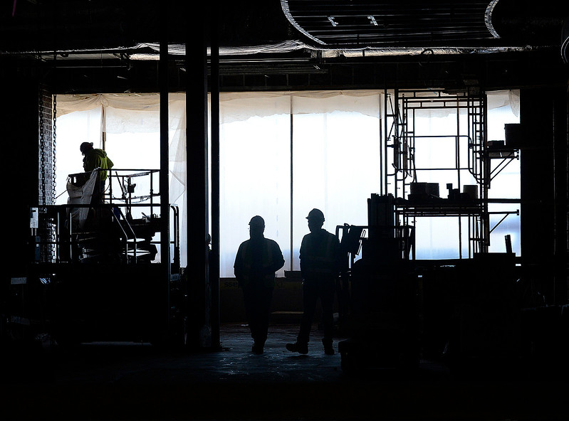 Construction crews are silhoutted as they work Wednesday, March 1, 2017, at the new Scheels store at the 2534 development in Johnstown. The 250,000 square-foot store plans to open its doors on Sept. 30 of this year. (Photo by Jenny Sparks/Loveland Reporter-Herald)