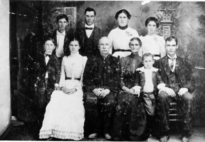 The Craig family - Patrick Craig front and center; Minnie Zoe Craig on the right in the back row (she is Buelah Milhoan's mother; my great-grandmother.)