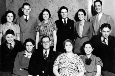 The Robbins Family: father Clinton Creed Robbins and mother Minnie Zoe Craig are front and center; from L to R in back are Beulah (my grandmother), Carl, Eulah, Cecil, Mildred, Hubert; in front on the left are Raymond and Audrey, and on the right are Blanche and Isham.