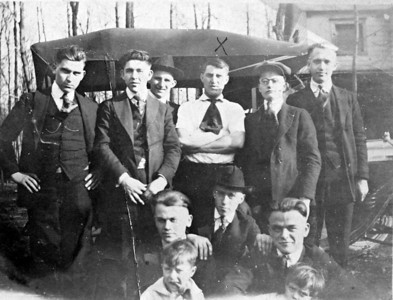 """X"" marks Gene Milhoan, my great grandfather and Garland Milhoan's father. To his left are his brother Ralph. The two boys in front are (L) great-uncle Gene and (R) Grandpa Garland Milhoan. I don't know who the others are."