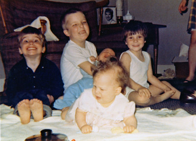 Rick and Ann with cousin John (on left) and two unidentified cousins (the babies)