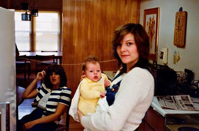 Ann with Kristen (Debbie in the background), 1982 (Ann age 18)