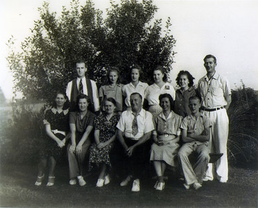 The Lauck Family: (back row, L to R) Walter, Mildred, Florence, Margaret, Lillian, Earl; (front row, L to R) Hattie, Louisa (my grandmother), Sophia, John, Dorothy, Bill.