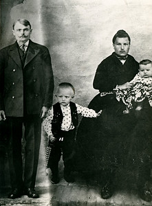 The Schneiders: John, John (Jr.), Anna and Peter (my grandfather). Looks like John Sr. was added later.