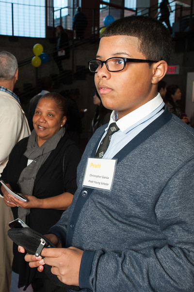 Pratt Young Scholar, Christopher, with mother.