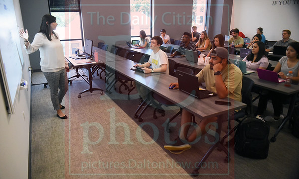 Matt Hamilton/Daily Citizen-News<br /> Cortnee Young, left, talks during a marketing and business class on Monday at Gignilliat Memorial Hall at Dalton State College.
