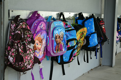 Backpacks Line the Wall at Newport Heights