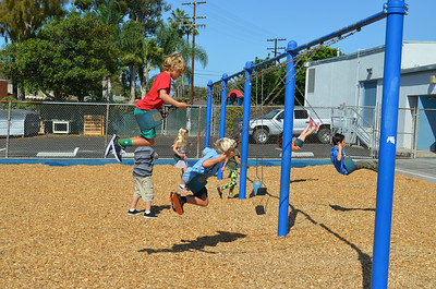 Students on the Swings at Newport Heights