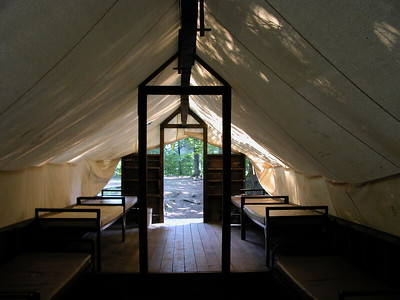 The inside of a canvas platform tent