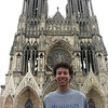 Geoffrey Cohen '06 stands in front of the cathedral in Reims, France, where he is currently living and teaching English to French middle schoolers.